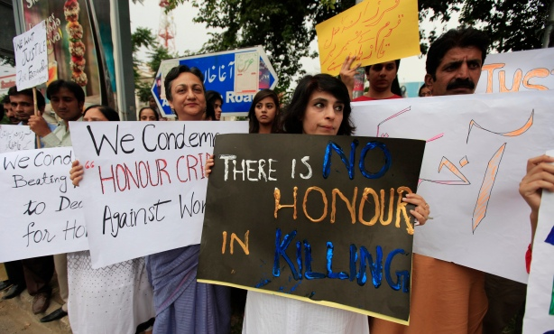Members of civil society and the Human Rights Commission of Pakistan hold placards during a protest in Islamabad May 29, 2014 against the killing of Farzana Iqbal, 25, by family members on Tuesday in Lahore. Pakistani Prime Minister Nawaz Sharif has demanded to know why police apparently stood by while Farzana Iqbal, a pregnant woman, was stoned and beaten to death by her family in front of one of the country's top courts, his spokesman said on Thursday. She was attacked on Tuesday, police said, because she had married the man she loved. Her husband said that police did nothing during the 15 minutes the violence lasted outside Lahore High Court. REUTERS/Faisal Mahmood    (PAKISTAN - Tags: CIVIL UNREST POLITICS CRIME LAW) - RTR3REE6